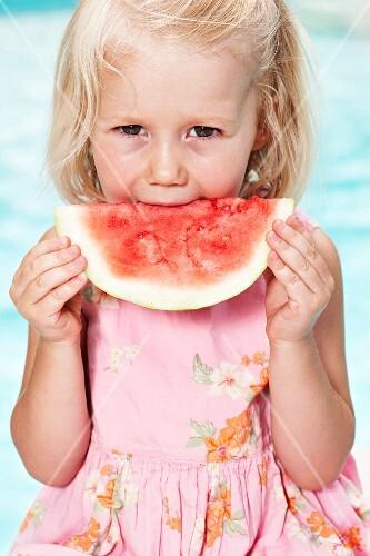 Portrait of girl eating watermelon
