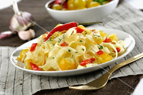 Tagliatelle with yellow cherry tomatoes and red chillis