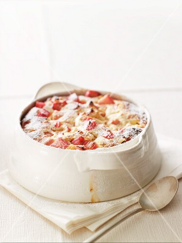 Baked rhubarb and quark dessert with icing sugar