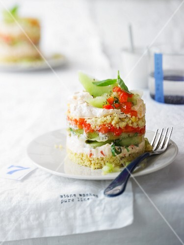 Savoury layered dish with peppers and cream cheese, melon, and nut couscous