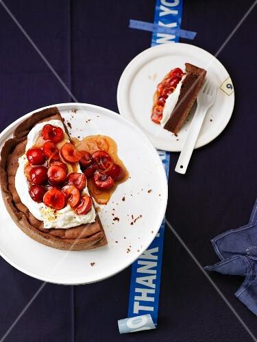 Chocolate fudge cake with cherries and orange & chilli cream