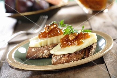 Canape with fig jam, walnuts and cheese