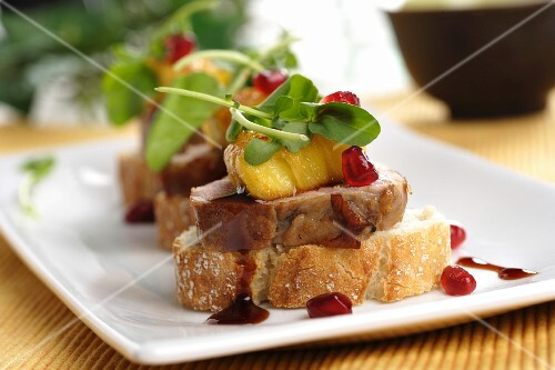 Pork canape with pineapple and raspberry vinegar