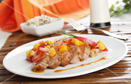 Sweet and sour pork tenderloin with peppers and rice