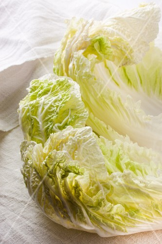Chinese cabbage leaves on an old linen cloth