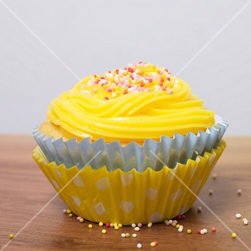 Vanilla cupcake with coloured sugar balls