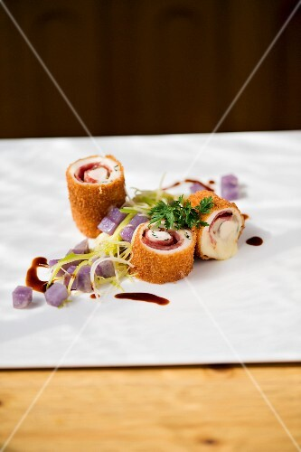Chicken Cordon Bleu with cheese, smoked sausage, leeks and purple potatoes