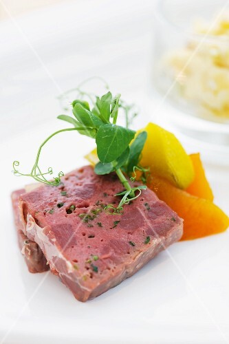 Game terrine with apple and shallots