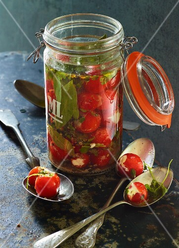 Cherry tomatoes stuffed with goat's cheese in a vanilla and herb infused pickling liquor