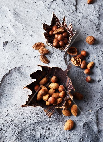 Assorted nuts in leaf-shaped bowls