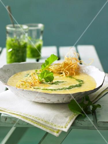 Potato soup with radish leaf pesto and potato straw