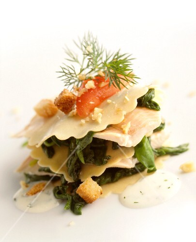 Pasta layered with trout fillet, spinach and croutons