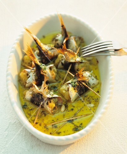 Rollmops with pine nuts in herb oil