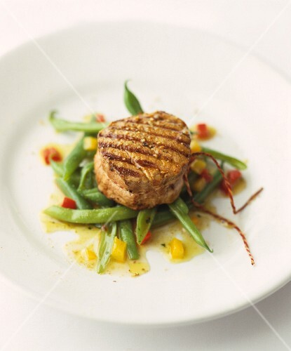 Grilled medallion of beef on green beans