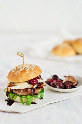 A burger with Brie, bacon and cherry sauce