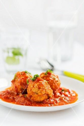 Millet dumplings in tomato sauce