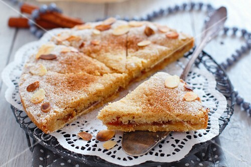 Semolina cake with jam filling and flaked almonds