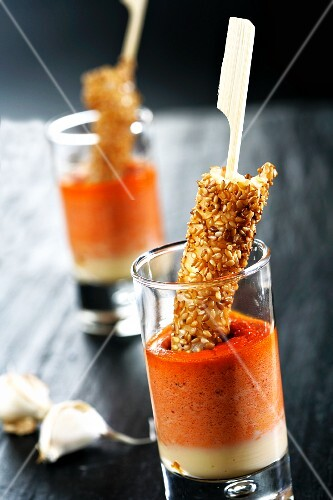 Tomato and pepper dip with prawn and sesame skewers