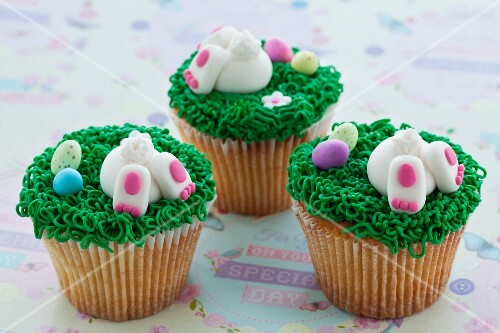 Vanilla cupcakes with buttercream and sweet Easter-themed decorations