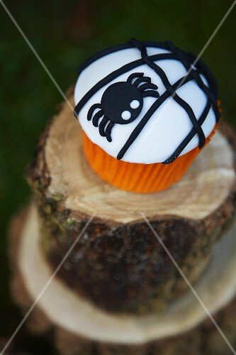 Cupcake decorated with a black spider for Halloween