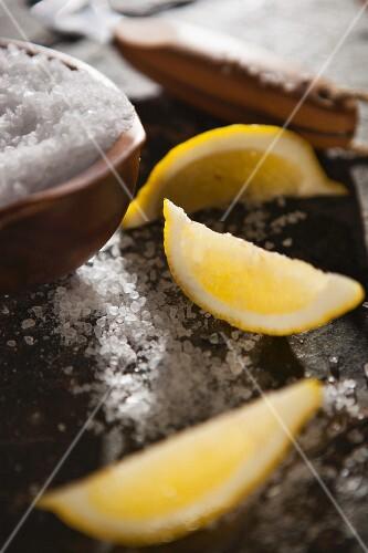 Lemon wedges and salt