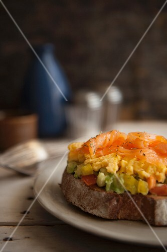 Toast with guacamole, scrambled egg and smoked salmon