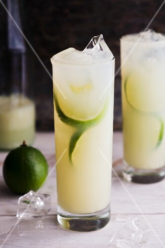 Vodka & lime cocktails with ice cubes