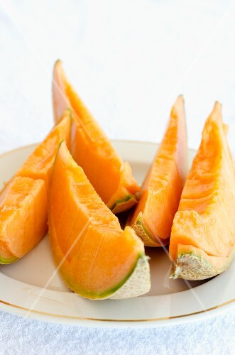 Slices of Cavaillon melon on a plate