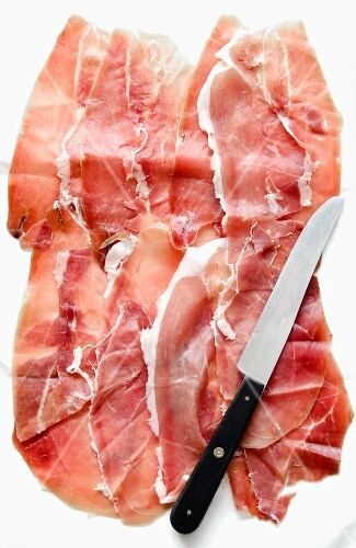 Several slices of Prosciutto from Sardinia, and a knife