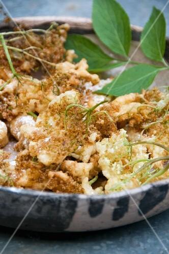Deep-fried elderflowers in a bowl