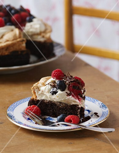 Brownie cake with cream and berries