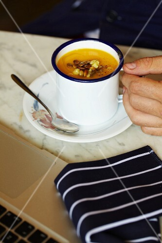 Creamy vegetable soup in a mug