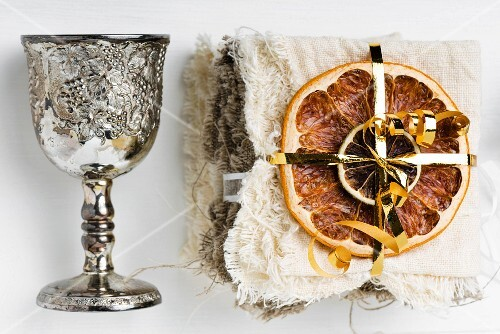 Dried fruits and a silver goblet as Christmas decorations