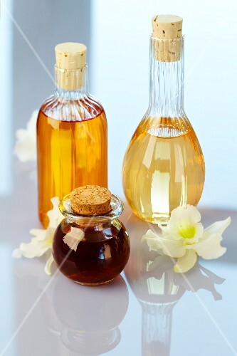 Perfume bottles with orchid flowers