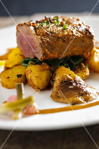 Lamb with spinach and spicy potatoes