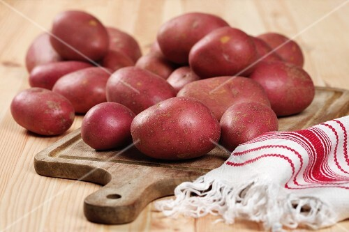 Red potatoes, of the variety Rooster, on a chopping board