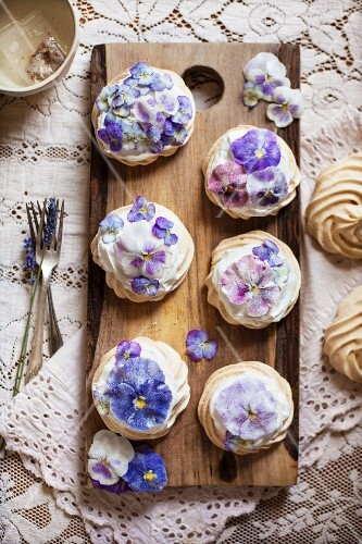 Candied Pansy and Viola Mini Pavlovas on a Wooden Board From Above