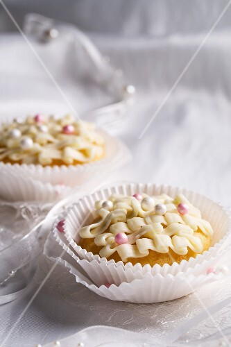 Decorated cupcakes with sugar balls for a wedding
