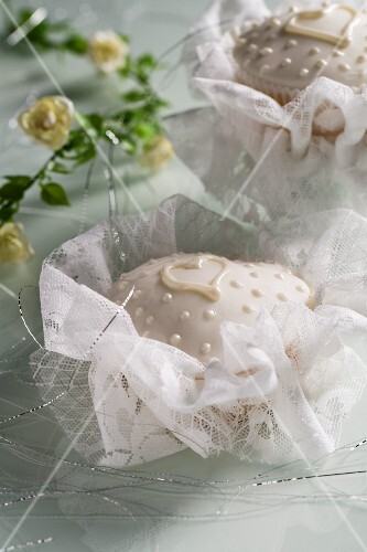 Cupcakes decorated in white for a christening