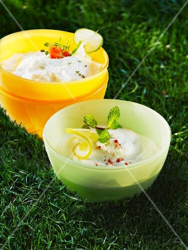 Cream cheese in bowls in a field