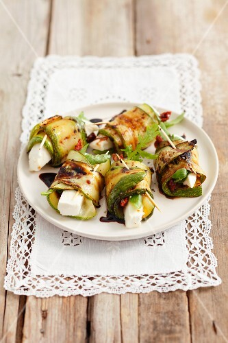 Barbecued rolls of courgette stuffed with feta, sundried tomatoes and rocket