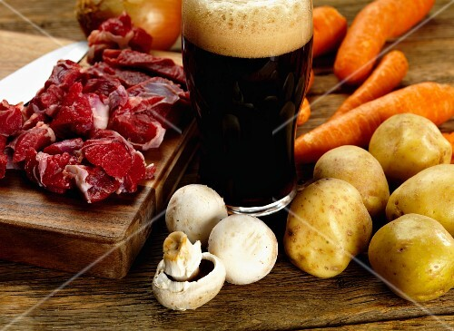 Ingredients for Irish stew: lamb, stout, mushrooms, potatoes, carrots and onions