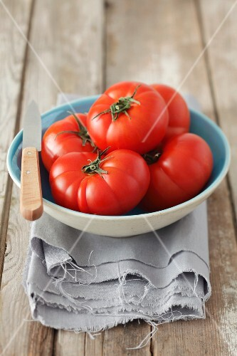 Several tomatoes in a bowl