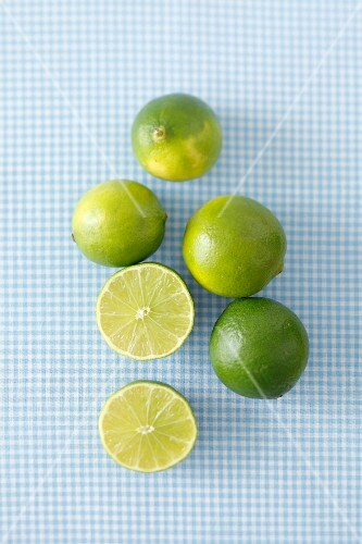 Several limes, whole and halved
