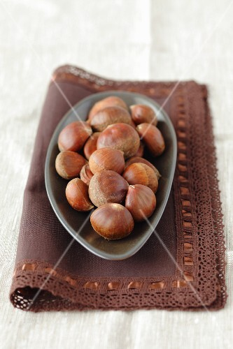 Chestnuts in a bowl on a napkin