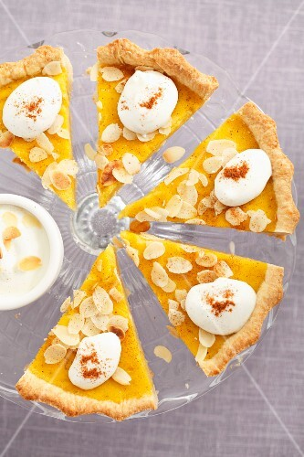 Pumpkin tart with flaked almonds, cut into slices