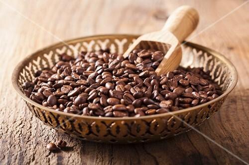Coffee beans in metal bowl