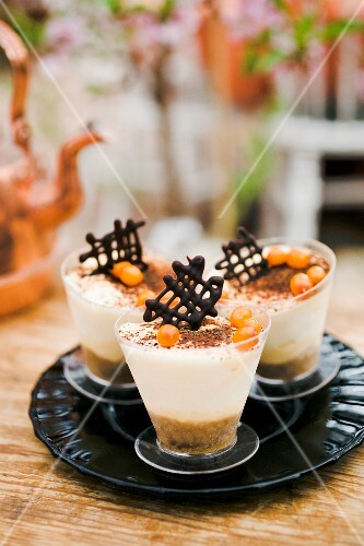 Tiramisu with sea buckthorn in small glasses