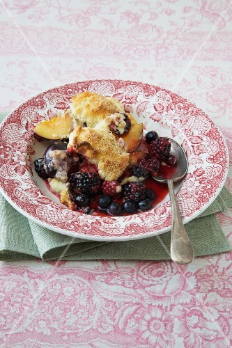 A portion of berry & plum cobbler on a plate