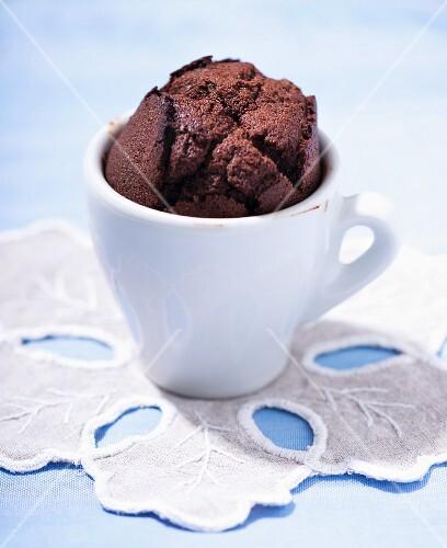 A chocolate muffin in an espresso cup